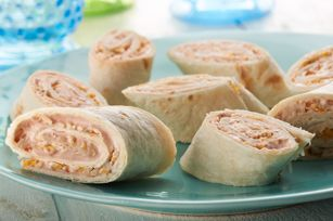 Salsa Roll-Ups recipe.   4 oz.  (1/2 of 8-oz. pkg.) PHILADELPHIA Neufchatel Cheese, softened  3 Tbsp. TACO BELL® HOME ORIGINALS® Thick 'N Chunky Salsa  4 flour tortillas (6 inch)  1/2 cup KRAFT Mexican Style 2% Milk Finely Shredded Four Cheese  1/4 tsp.  chili powder  MIX Neufchatel and salsa; spread onto tortillas. Top with remaining ingredients.   ROLL up tortillas tightly. Cut each crosswise into 5 slices.
