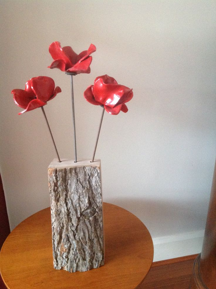 A stand for some Tower of London poppies in red elm