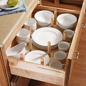 Pegged built in dish cabinets from Thomasville. You could do this by simply placing peg board at the bottom lifted just slightly off the bottom of the drawer