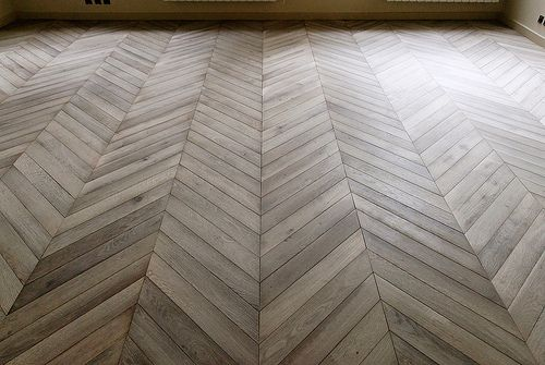 Chevron parquet by Atelier des Granges.