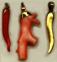 """The cornuto, corno, or cornicello is an Italian amulet of ancient origin. Corno means """"horn"""" and cornicello means """"little horn"""" -- these names refer to a long, gently twisted horn-shaped amulet worn in Italy to protect against the evil eye."""