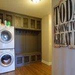 Gray mudroom bench with stacked washer and dryer