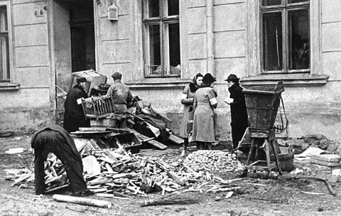 A group of Jews chop furniture to use as fuel in the Krakow ghetto.