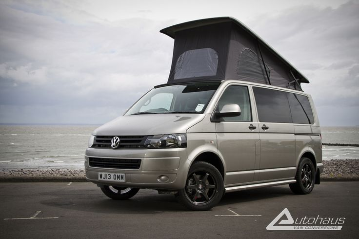 A Metallic Sand Beige VW Camper from Autohaus. This model is an 'Ashton' with a twin RIB rock n roll bed and Reimo front elevating roof.