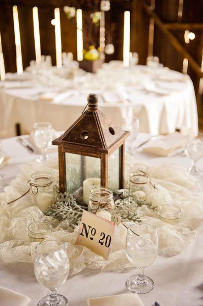 lantern centerpiece with small mason jars dressed in twine