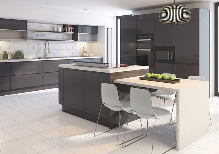 Cut Price Kitchens Sculptured Grey Gloss Kitchen. Stylish and modern design. Wrapped in high gloss dark grey pvc. Integral handle to create a minimalist look. Fully matching pvc panels available. Curved units, bifold cupboards and double pan drawers available. Comprising of 18mm thick carcases, soft-close hinges and benefits from 330mm deep wall cabinets. www.cutpricekitchens.co.uk