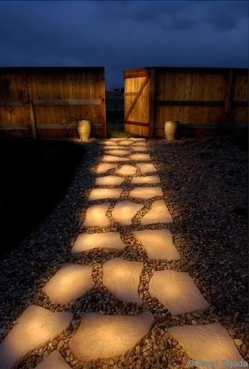 "Pathway of rocks painted with glow in the dark paint (Rust-Olem Glow in the Dark Brush-on Paint). During the day they ""charge"" in the sun and in the evening they reflect stored light! How cool!"