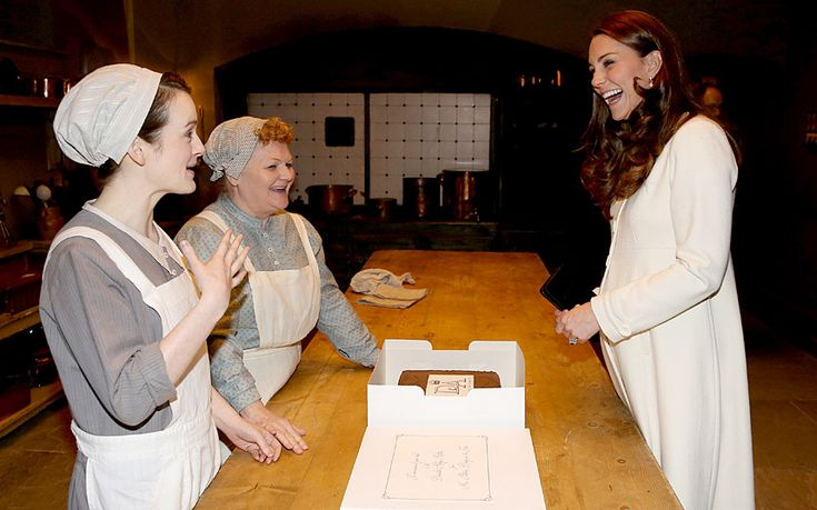 Daisy (Sophie McShera) and Mrs Patmore (Lesley Nicol) present Kate with a special Downton Abbey cake in the kitchens