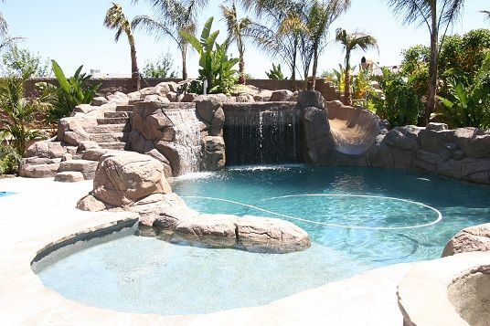 Pool Designs With Rock Slides 20 unique outdoor swimming pool design ideas inspiring water features This Pool But Longer With Dark Rocks Hot Tub Diving Board And Swim Up Barstools Would Be Perfect Want It Home Pinterest Diving Board