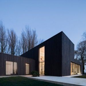 Huize Looveld is a blackened timber house  built on the site of a razed farmstead