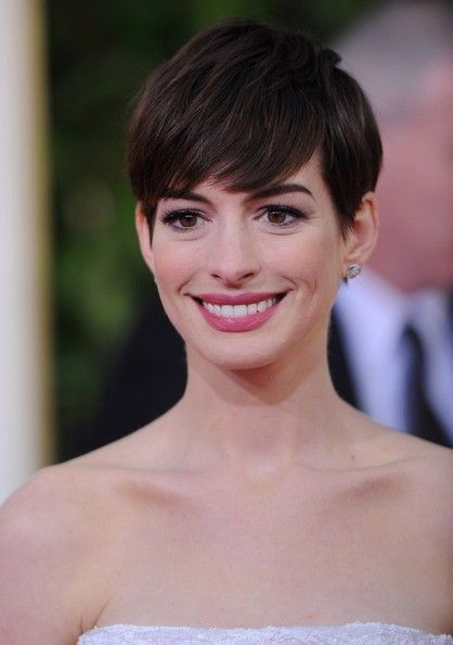 Anne Hathaway Pixie - Anne Hathaway might have cried when she first chopped off her long brunette locks, but the star looked full of confidence with this effortless pixie cut at the 2013 Golden Globe Awards.
