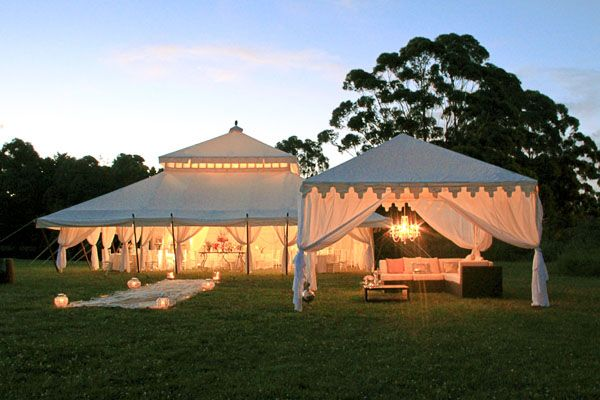 I like this tent    Outdoor tented wedding & reception - I'm not sure that I want to get married in a church.  Probably just outside, so why not have the reception right on site under glowing tents.  I really love that this one has different tents dedicated to different purposes - dining & dancing & lounging.  I just hope there would be gardens nearby.