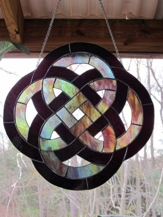 Celtic Irish Knot Stained Glass Window Panel Suncatcher.   Use this pattern for a stained glass window and rainbow colors with grey outside border.