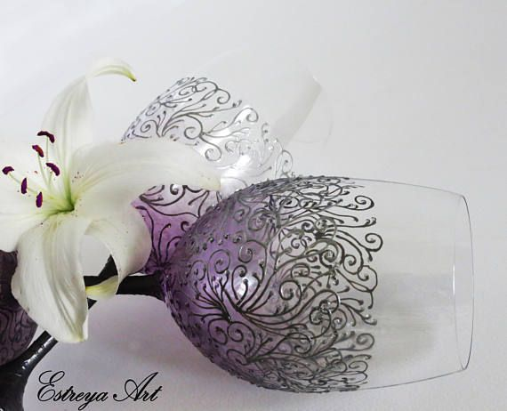 """Set of two hand painted wine glasses """"Romance in silver and purple"""". These beautiful glasses with painted lace are in silver and purple with a hint of glitter. Lace design brings a sense of sophistication and style. They are unique and perfect present for weddings, anniversaries, birthdays, special occasions or just for romantic /special dinners. This set is ready to ship. All items can be personalized with short text as names and/or date written at the base of the glasses /..."""