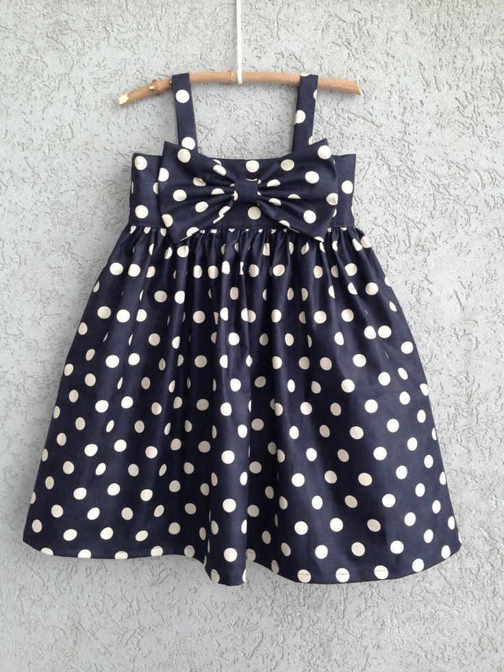 Navy polka dot baby/toddler bow dress. $65.00, via Etsy.