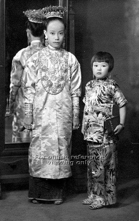 PERANAKAN BRIDE AND A YOUNG GIRL IN SAMFOO, PENANG, Malaysia - 1940s to 1950s