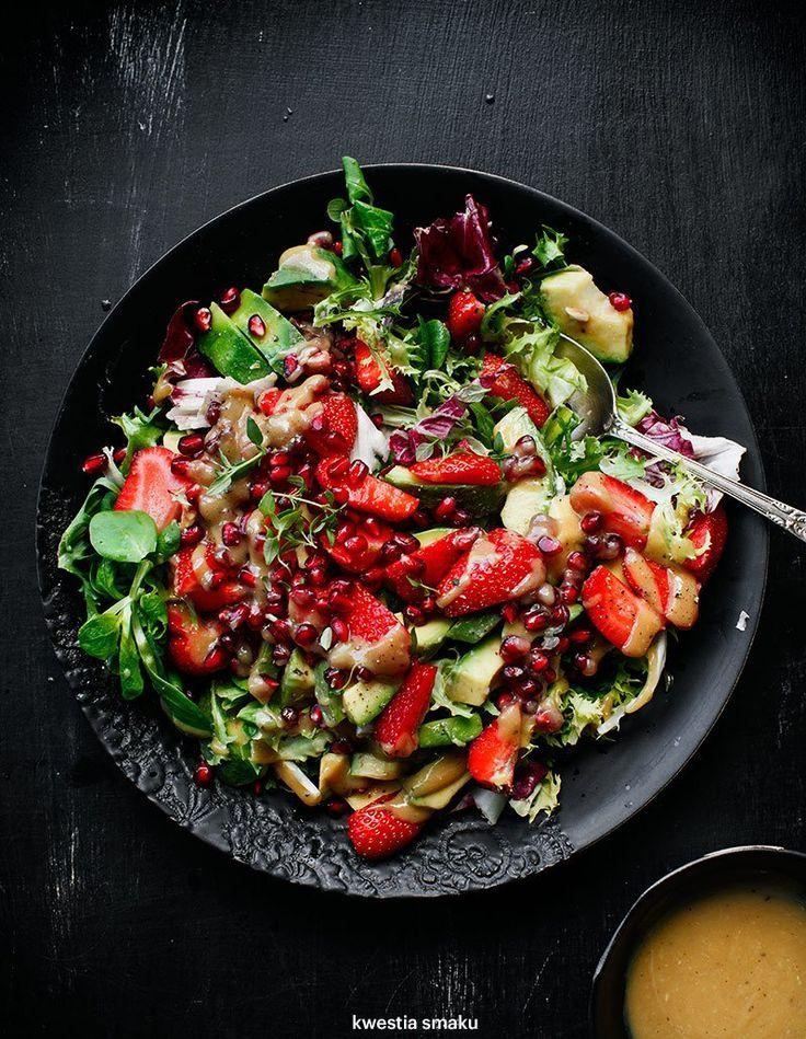 Strawberry, avocado, pommegranate and tahini dressing salad.