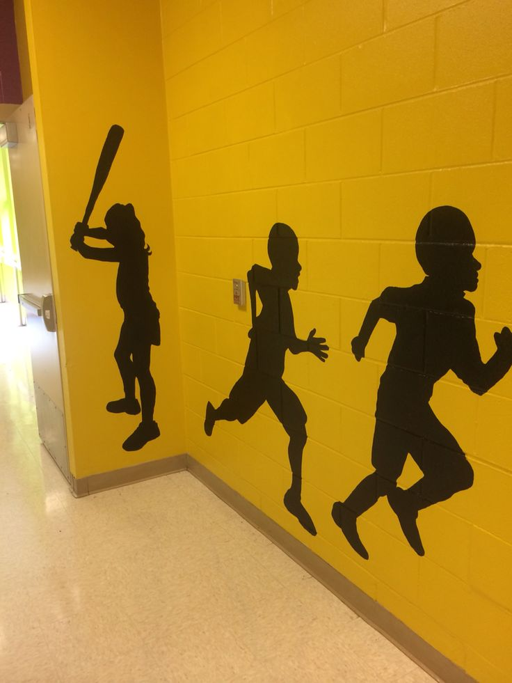 """Actual students of the school used to paint silhouettes on the wall. """"Leaders in action"""" at Woodland Forrest Elementary school. A Leader in Me school."""