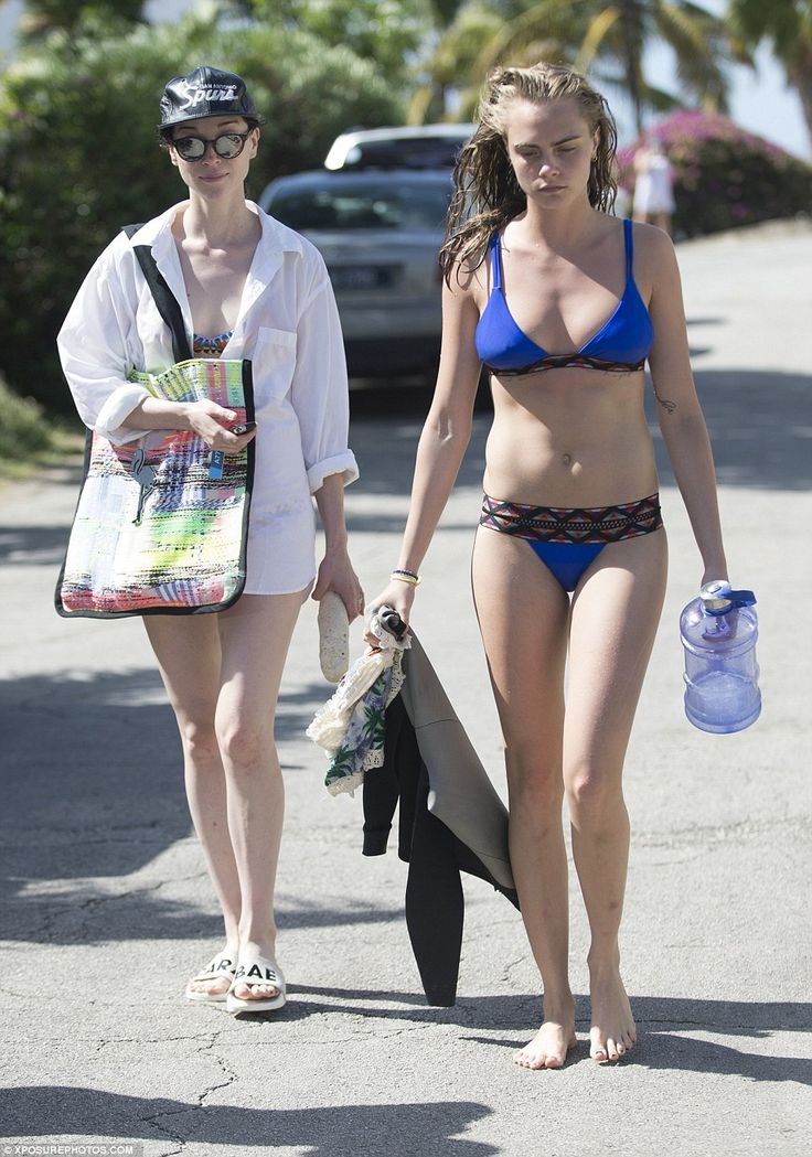Day at the beach: Cara Delevingne looked sensational in a bright blue bikini as she joined girlfriend St. Vincent at the beach on Sunday as the pair continued their endless holiday in Barbados