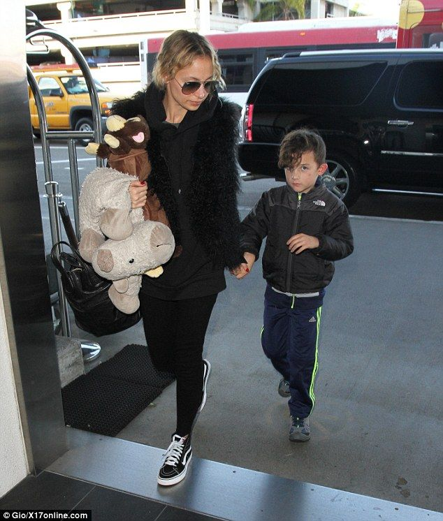 So fly: Nicole Richie, 35, her husband Joel Madden, 37, and their two children, Harlow, eight, Sparrow, seven, jetted out of Los Angeles on Wednesday