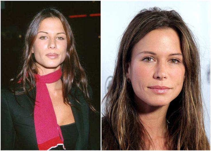 Rhona Mitra`s eyes color - light brown and hair color - dark brown