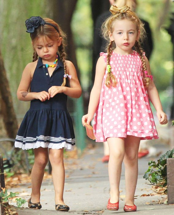 October 3, 2013 - The girls, who both donned headbands Carrie Bradshaw would be proud of, looked unhappy to be heading to school on such a beautiful morning.
