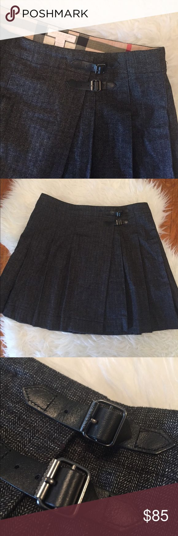 """Burberry Herringbone Pleated Kilt Skirt Authentic, like new condition Burberry skirt, girl's size 14.  No flaws.  70% cotton, 16% polyester.  Opens fully, button and buckle closure.  Buckle hardware have Burberry stamped on them.  Hidden adjustable elastic inside the waistband for a perfect fit.  16"""" long.  This is a girls size 14, would fit like a woman's extra small.  I'll provide more measurements if needed. Burberry Bottoms Skirts"""