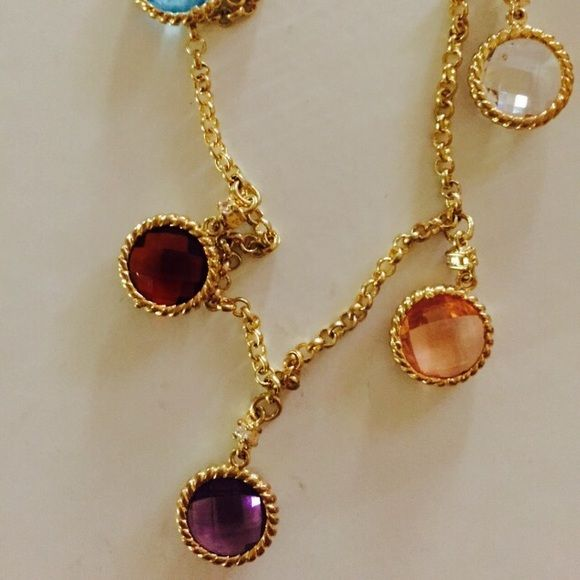 Multi Colored Goldtone Gemstone Necklace Oh so beautiful yellow goldtone necklace with 5 different colored gemstones, each gemstone has  tiny clear stone next to it, it looks like a fine jewelry💕 NWT. Please note that this is a high quality costume jewelry😍 Please see pictures for more details. Please feel free to ask me any questions you might have. Thank you😍 Jewelry Necklaces