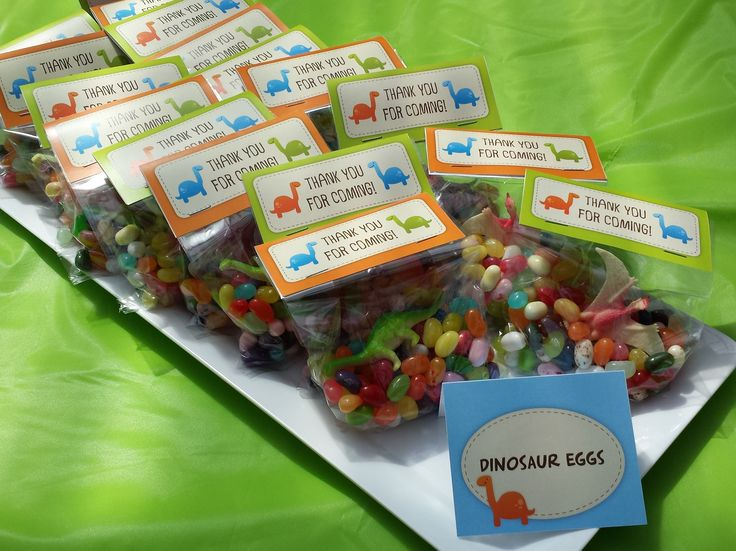 Party bags full of dinosaur eggs (Jelly Belly beans). Printables by mypartydesign on Etsy. See the full dino-riffic party blog at http://easybreezyparties.com.au/party-inspiration-and-ideas/item/41-rrroar-thomas-first-birthday-dinosaur-party.html