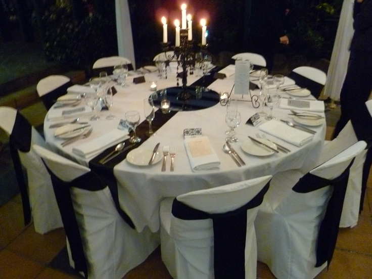 Black candelabras with black satin runner