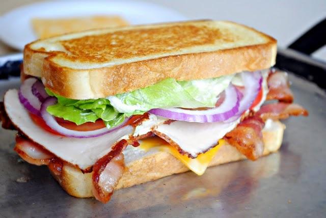 BLT + Turkey + Mayo + Red Onion + Cheese = A BLT Club Sandwich.--Looks delicious