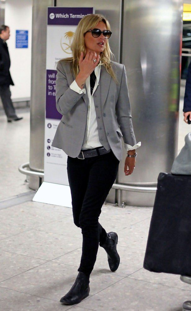 Kate layers it up with a dove gray blazer over skinny black pants.