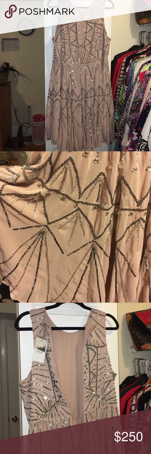 Asos Formal Dress Brand new, never worn. Bought for a wedding. Originally $300 with shipping. Back zipper and hangs right at the knee. I'm 5'6. It's a beautiful Aztec print and shines. It's a creamy pinkish color. ASOS Curve Dresses Prom