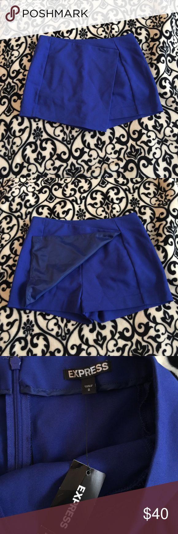 Royal blue skort Royal blue skort with back zipper. NWT never worn tag says 2 but fits more like a 4 Express Shorts Skorts