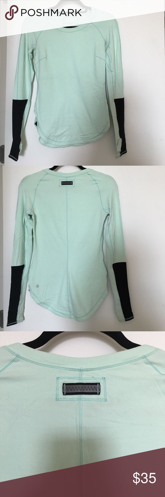 Lululemon Green Long Sleeve Top with Black Detail Lululemon Green Long Sleeve Top with Black Detail on Sleeves, end of side seams, and reflective strip on back. Softest fabric. Worn twice. lululemon athletica Tops Tees - Long Sleeve