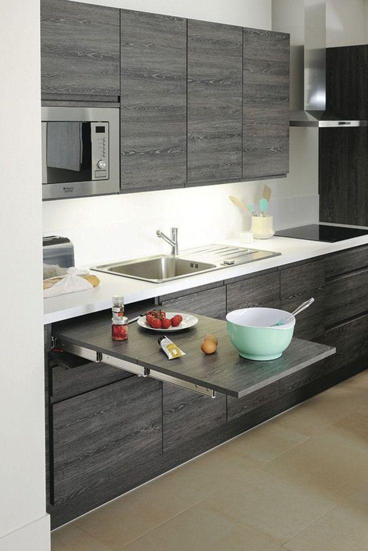 Table extractible dissimulée, 1 mètre de longueur, cuisine Pure, en chêne gris,  GRIS, implantation type cuisine 2792 euros, Cuisinella
