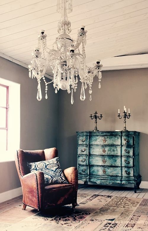 Love the color combination in this room except  for the pillow. Not a fan of navy blue at all. And the rug...not loving the rug. I guess I just love the walls, dresser and chair. And the chandelier...I love chandeliers.