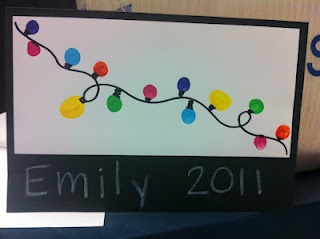 """""""We Can Light up Your Life"""" Student dip their fingers in paint to create the bulbs for the x-mas lights."""