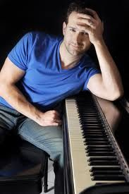 masculine, casual pose with piano