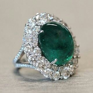 Fabergé emerald cabochon ring features a Gemfields  Zambian emerald and round white diamonds, set in platinum.