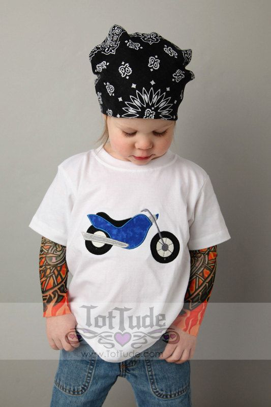 This tattoo sleeve shirt is perfect for your little biker! This hip, cute and comfy shirt features a cool motorcycle applique.