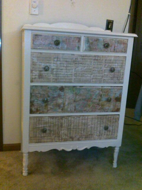 Dresser I re-did. Paint, modge podge on some old maps and sheet music...and some stain to make em look worn...a brand new/old dresser for 12 bucks!