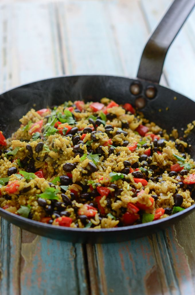 Black bean quinoa curry rice is cooked with vegetables and spices. A light meal on its own or a flavorful side dish. Gluten-free dish, or vegan adaptable.