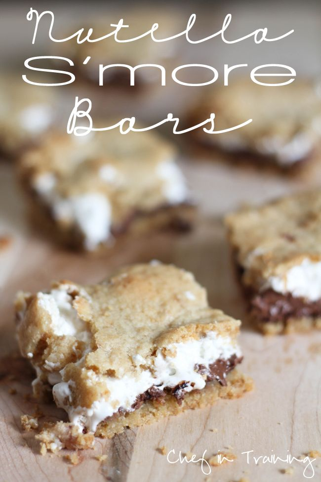 Nutella S'more Bars!  •1/2 cup butter softened  •1/4 cup brown sugar   •1/2 cup sugar   •1 egg   •1 tsp. vanilla extract   •1 1/3 cups flour   •3/4 cup graham cracker crumbs   •1 tsp. baking powder   •1/4 tsp. salt   •1 cup Nutella   •1 (7 oz.) jar marshmallow creme/fluff