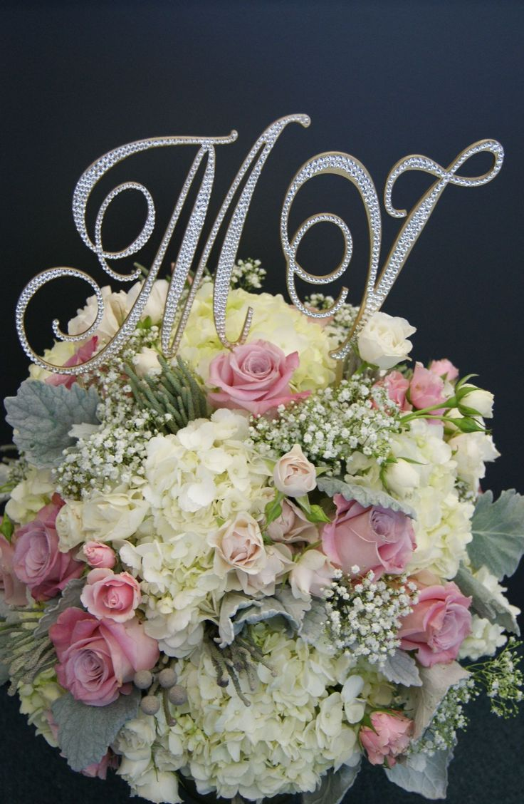 """6"""" Love Letters on a beautiful floral arrangement by Berries and Blooms."""