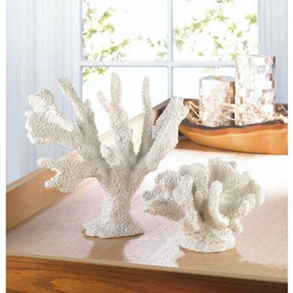 <p>A little bit of oceanfront style goes a long way when it comes to room accents. This pretty coral-like statue features fantastic texture and a fresh white finish that will liven up your space.