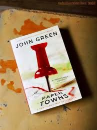 "John Green - Paper Towns.  ""I'm not sure what you're supposed to say to the checkout woman at twelve-thirty in the morning when you put thirteen pounds of catfish, Veet, the fat-daddy-size tub of Vaseline, a six-pack of Mountain Dew, a can of blue spray paint, and a dozen tulips on the conveyor belt..."""