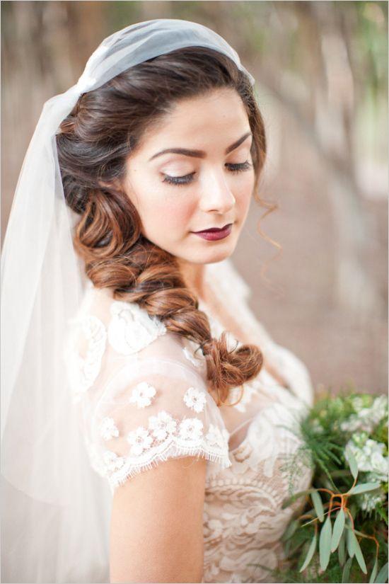 Large braid with sweeping veil. #weddinghair #bridals #weddingchicks Hair: Cassandra Russek ---> http://www.weddingchicks.com/2014/05/05/little-women-woodland-wedding/