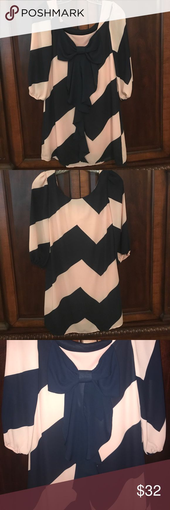Pink and Navy Chevron Bow Back Dress- LIKE NEW This dress is so cute! It has a scoop back with a ruffled bow that extend to the bottom of the dress. I purchased it from Dillards and rarely wore it, so it is in PERFECT condition. Please let me know if you have any questions! Gianni Bini Dresses