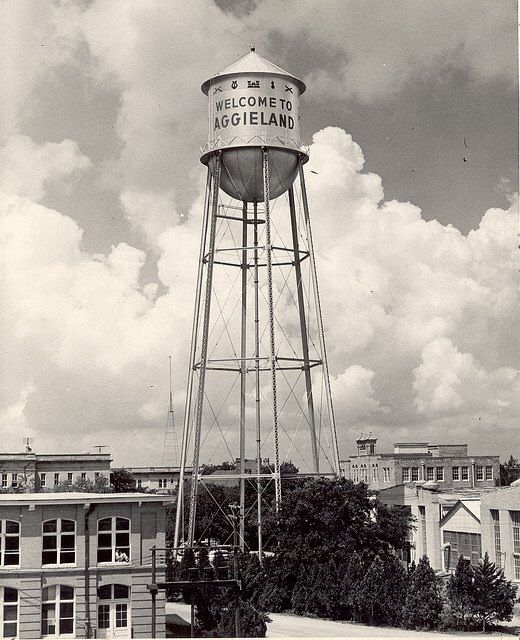 Original Texas AM water tower in the 1930s. Photo courtesy Texas AM University Libraries.  ~ Check this out too ~ RollTideWarEagle.com sports stories that inform and entertain and Train Deck to learn the rules of the game you love. #Collegefootball Let us know what you think. #Aggies